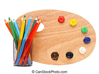 wooden artists palette loaded with various colour paints and...