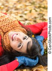Happy joyful woman on autumn park