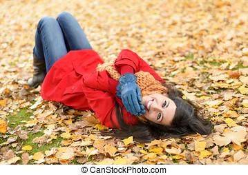 Joyful happy woman on autumn