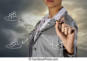 Concept image of social network - woman's hand draws a...
