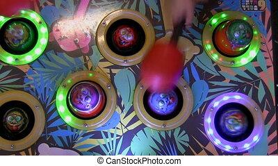 Children amusement game machine - Children playing hammer...
