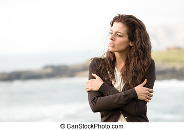 Heart broken sad woman - Sad shivery woman in brown sweater...