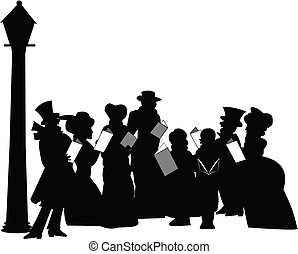 carolers under streetlamp - large group of carolers in...