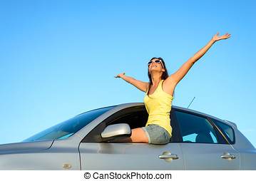 Female driver bliss on car - Joyful woman sitting on window...
