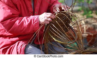 Weaving wicker basket - Old man weaving wicker basket in the...