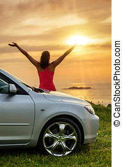 Car traveler looking summer sunset - Free woman on car...