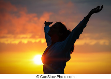 Happiness and peace on golden sunset - Free woman raising...