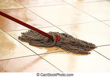 cleaning the floor with a mop - cleaning the floor with a...