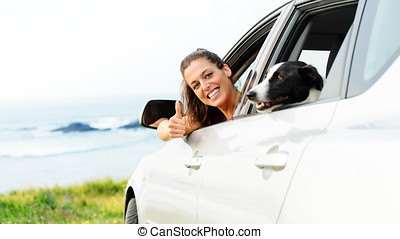 Woman traveling with dog pet - Happy woman traveling in car...