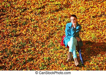 Young woman in depression outdoor autumn park - Young...