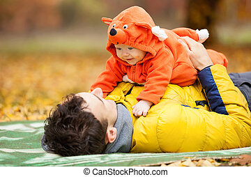 Father and his son in fox costume - Young father and his...