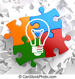 Light Bulb Icon on Multicolor Puzzle. Idea Concept.