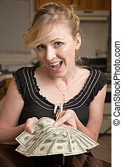 Windfall - Blond woman in casual attire with a happy...