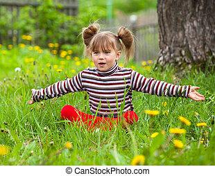 Funny lovely little girl in park