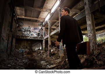 Confused Business man inside a Destroyed Building