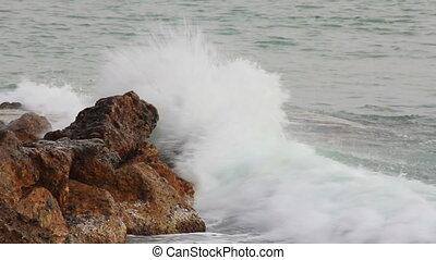 sea waves breaking on rock - slow motion