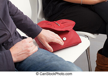 Bag stealing - The pickpocket is going to steal the woman's...