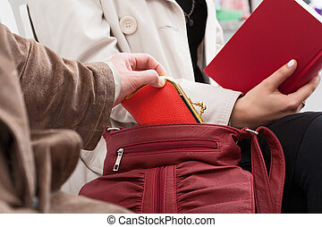 Theft the wallet - The pickpocket is stealing the woman's...