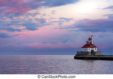 Lighthouse Overlooking Beautiful Lake Superior At Sunset...