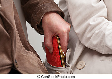Stealing - Pickpocket are stealing a woman's purse in the...