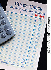 Guest Check and calculator, concept of restaurant expense