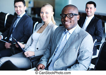 Business conference - Image of business people sitting in...