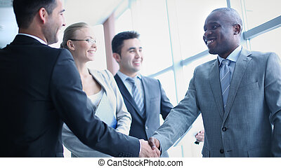 Business agreement - Image of businessmen handshaking on...