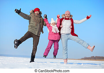 Happiness - Happy parents and their daughter having fun in...