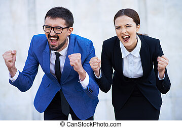 Yes - Businessman and his colleague showing their gladness