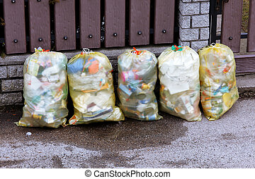 Plastic garbage bags with rubbish...