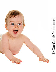 Small children in diapers baby lies on the ground