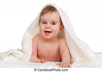 Small amazing child in the baby blanket