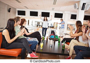 Friends Applauding For People Bowling - Group of friends...