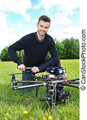 Engineer Fixing Propeller Of Octocopter - Portrait of young...