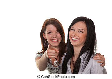Two young women breaking into laughter