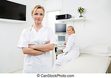 Confident Gynecologists In Examination Room - Portrait of...