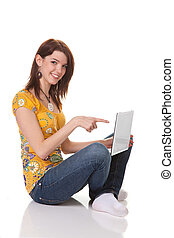 Young successful woman with a laptop looking forward