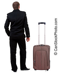 back view of business man in black suit traveling with suitcas .   Businessman looks ahead.  Isolated over white background. Rear view people collection. backside view of person.