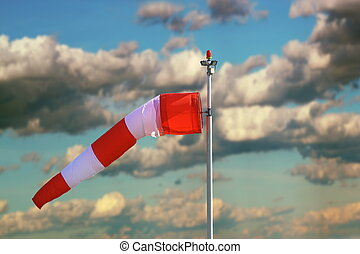 windsock over stormy sky - windsock at the airport over a...