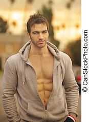 Handsome fit man - Sexy fit young man outdoors in golden...