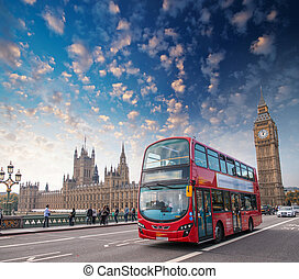 London. Classic red double decker bus crossing Westminster...