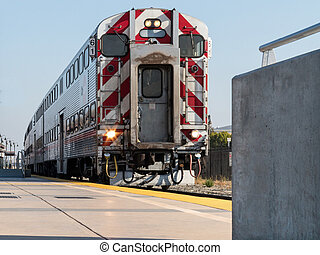 Train 61 at the platform in California - Double deck...