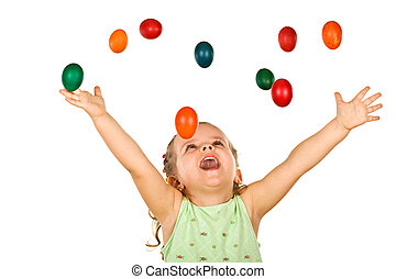 Happy shouting little girl with falling easter eggs - Happy...