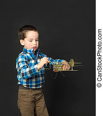 boy playing with a model airplane