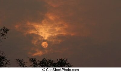 Cloudy Sun - Sunrise during peak hazy season in Asean in...
