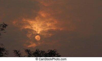 Cloudy Sun - Sunrise during peak hazy season in Asean in...