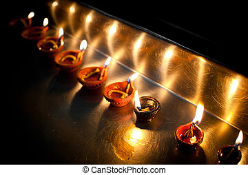 Burning oil lamps. India