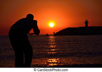 photographer taking pictures on the beach