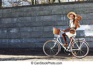 woman on a bike tour in the city park