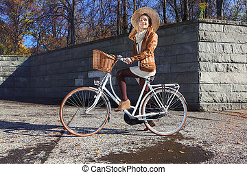 city bike - woman on a bike tour in the city park